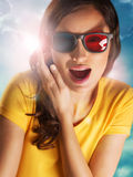 Portrait of happy woman with stereo glasses. Over dramatic bright background royalty free stock image