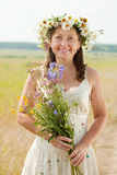 Portrait of happy woman in summer field. Portrait of happy mature woman in camomile chaplet in summer field stock photos