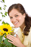 Portrait of happy woman with sunflower Stock Images