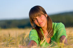 Portrait of happy woman in sunset corn field Stock Photos
