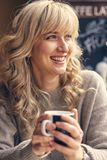 Portrait of a happy woman thinking and looking away. At breakfast on vacation Royalty Free Stock Images