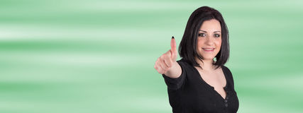 Portrait of happy woman with thumb up Stock Photo