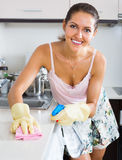 Portrait of happy woman tidying cabinets Royalty Free Stock Images