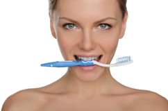 Portrait happy woman with toothbrush in teeth Stock Photos