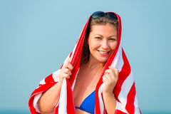 Portrait of happy woman with a towel Stock Images