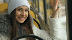 Portrait of happy woman during tram ride. Beautiful attractive girl walking on a winter city in Siberia stock video
