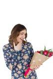 Portrait of happy woman with tulip bouquet Stock Photo