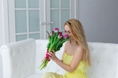 Portrait of happy woman with tulip bouquet. 8 march international womens day Royalty Free Stock Image