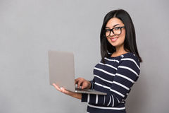 Portrait of a happy woman using laptop Royalty Free Stock Photo