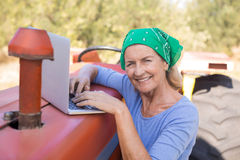 Portrait of happy woman using laptop Royalty Free Stock Photo