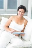 Portrait of happy woman using tablet Stock Photos
