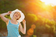 Portrait of happy woman on vacation Stock Photo