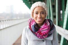 Portrait of happy woman in warm clothing standing outdoors Stock Image