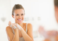Portrait of happy woman washing hands in bathroom Stock Photos