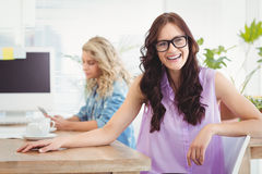 Portrait of happy woman wearing eyeglasses at desk Royalty Free Stock Photos