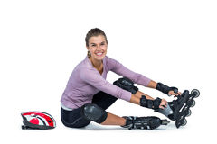 Portrait of happy woman wearing inline skates Royalty Free Stock Photos