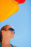 Portrait of happy woman on windy beach Stock Photos