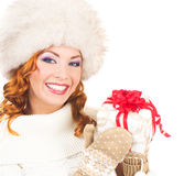 Portrait of a happy woman in a winter hat holding a present Royalty Free Stock Image