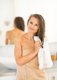 Portrait of happy woman wiping hair with towel Stock Photography
