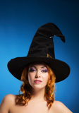 Portrait of a happy woman in a witch hat Royalty Free Stock Images