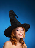 Portrait of a happy woman in a witch hat Royalty Free Stock Photography