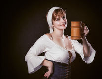 Happy woman with a wooden mug Royalty Free Stock Photos