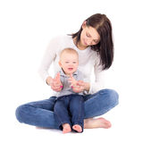 Portrait of happy woman woth her little son sitting isolated on Stock Photo