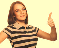 Portrait happy woman young girl shows positive sign thumbs yes, Stock Photo