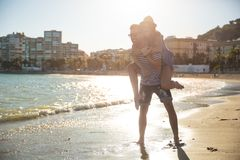 Happy woman being carried on her boyfriend back Royalty Free Stock Photography