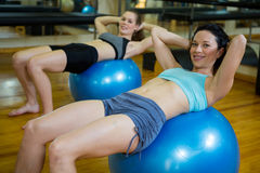 Portrait of happy women exercising on fitness ball Stock Photo