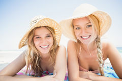 Portrait of happy women lying on the beach Royalty Free Stock Photos