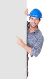 Portrait of happy worker presenting empty banner Royalty Free Stock Images