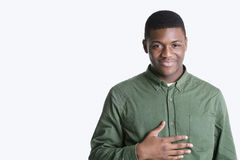 Portrait of a happy young African American man over gray background Stock Photo