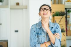 Portrait of happy young Asian woman laughing against at home off royalty free stock photography