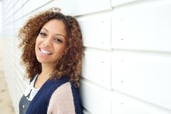 Portrait of a happy young attractive female smiling outdoors Royalty Free Stock Photos