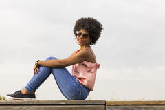 Portrait of  a Happy young beautiful afro american woman sitting Royalty Free Stock Photography