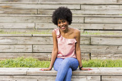Portrait of  a Happy young beautiful afro american woman sitting Stock Photos