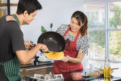 Asian couple at kitchen room stock photos