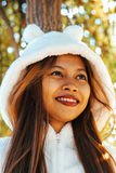 Portrait of a happy young beautiful woman in autumn season in white woolen jacket outdoor with colorful autumn background.  royalty free stock images