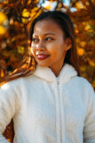 Portrait of a happy young beautiful woman in autumn season in white woolen jacket outdoor with colorful autumn background. Portrait of a happy young beautiful stock photos