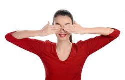 Portrait of a happy young beautiful woman with her hands up covering her eyes. Stock Photos