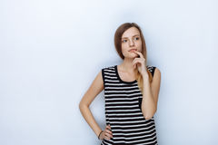 Portrait of happy young beautiful woman in striped shirt touching her lips posing for model tests against white studio background Stock Photography