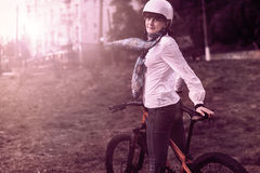 Portrait of happy young bicyclist riding in park Royalty Free Stock Photos