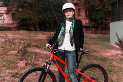 Portrait of happy young bicyclist riding in park Stock Photography