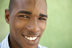 Portrait of happy young black man looking at camera and smiling Royalty Free Stock Photography