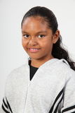Portrait happy young black school girl in studio Stock Photos