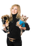 Portrait of happy young blonde with two dogs Royalty Free Stock Photography
