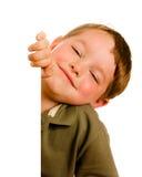 Portrait of happy young boy child peeking. Around corner isolated on white Stock Photo