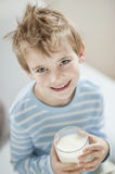 Portrait of happy young boy drinking milk Royalty Free Stock Image