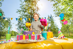 Portrait of happy young boy holding birthday gifts Stock Images